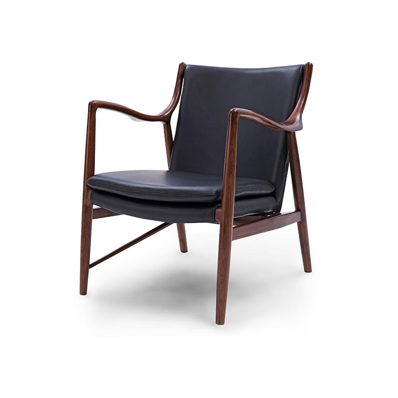 北欧休闲椅设计师创意皮沙发椅子酒店咖啡厅实木扶手靠背椅