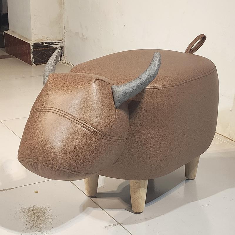 人气牛凳子创意坐墩脚踏儿童坐凳可爱卡通家用头层牛皮动物换鞋凳